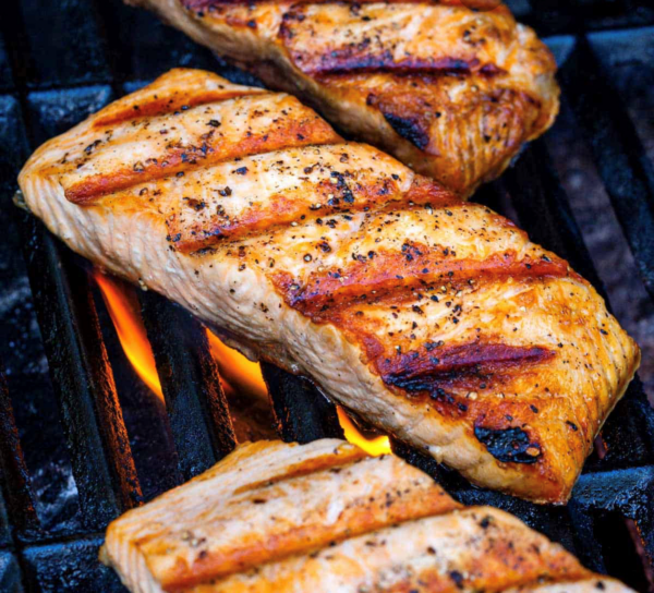 Grilled salmon steaks on the grill.